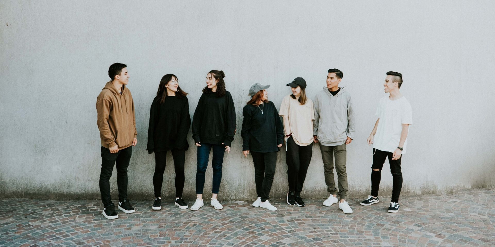 A group of youth by a wall