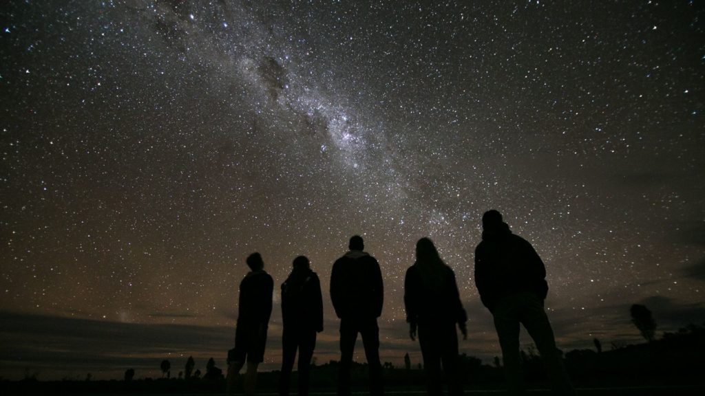 Family look up at stars