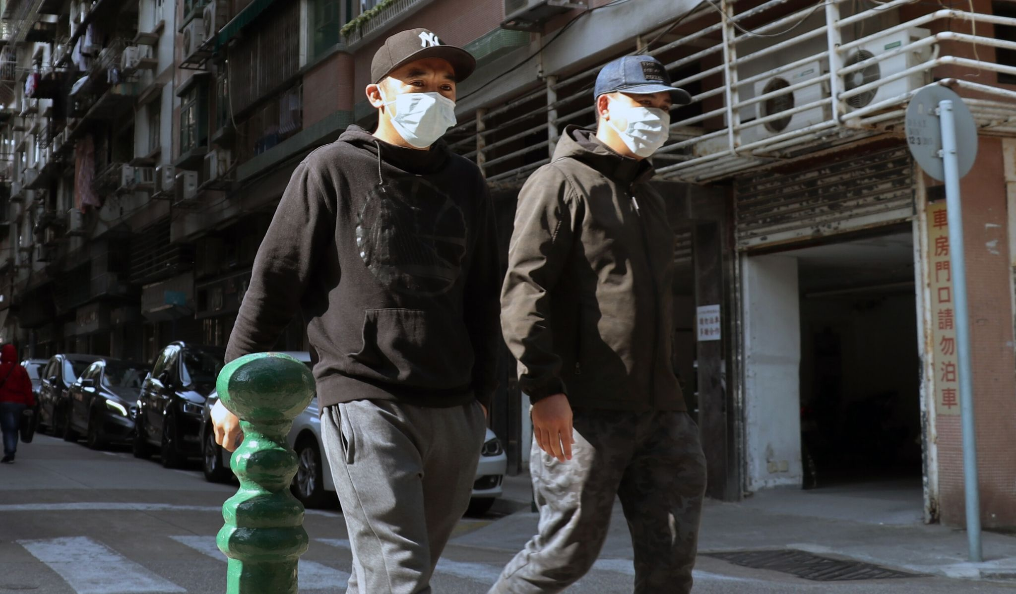 Two men walking with face masks on