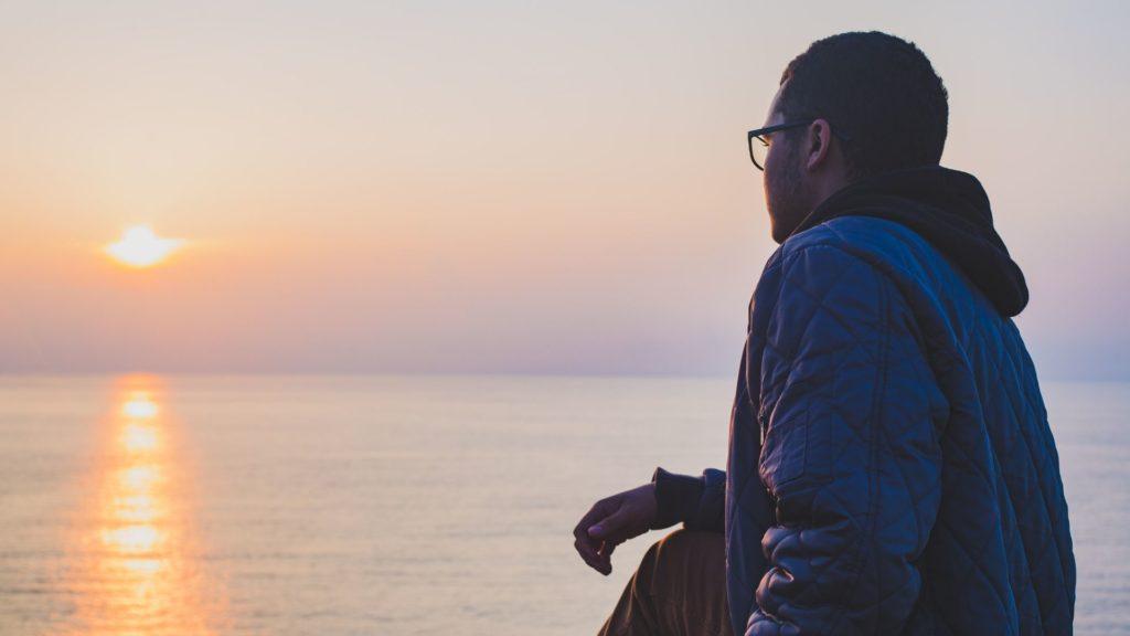Boy in awe of sunset