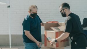 Men doing volunteer work during COVID-19