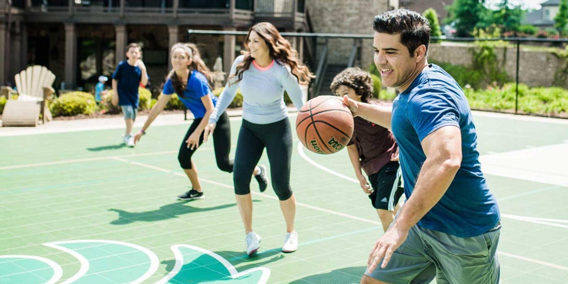 family-playing-basketball