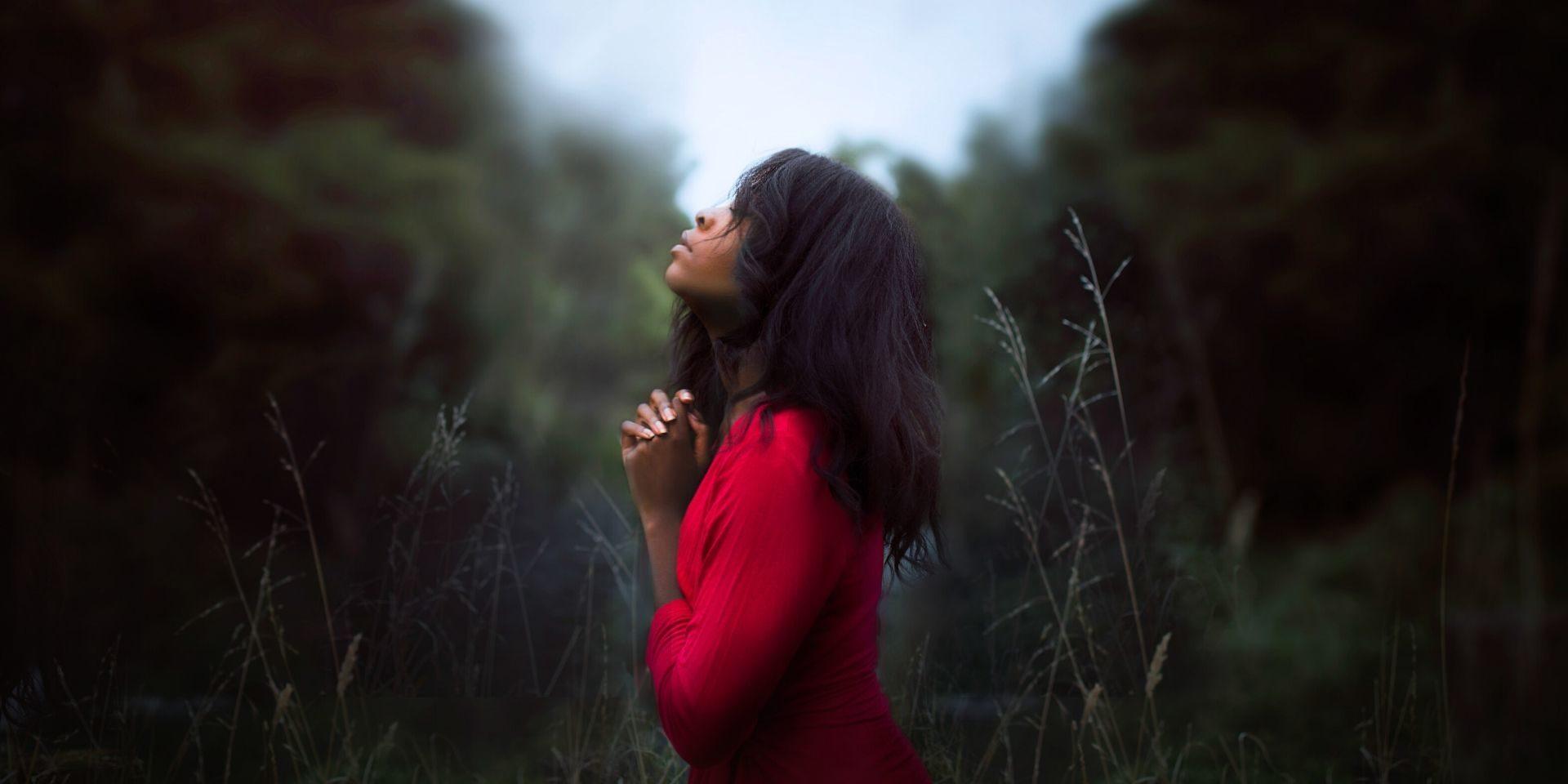 Girl praying towards heaven